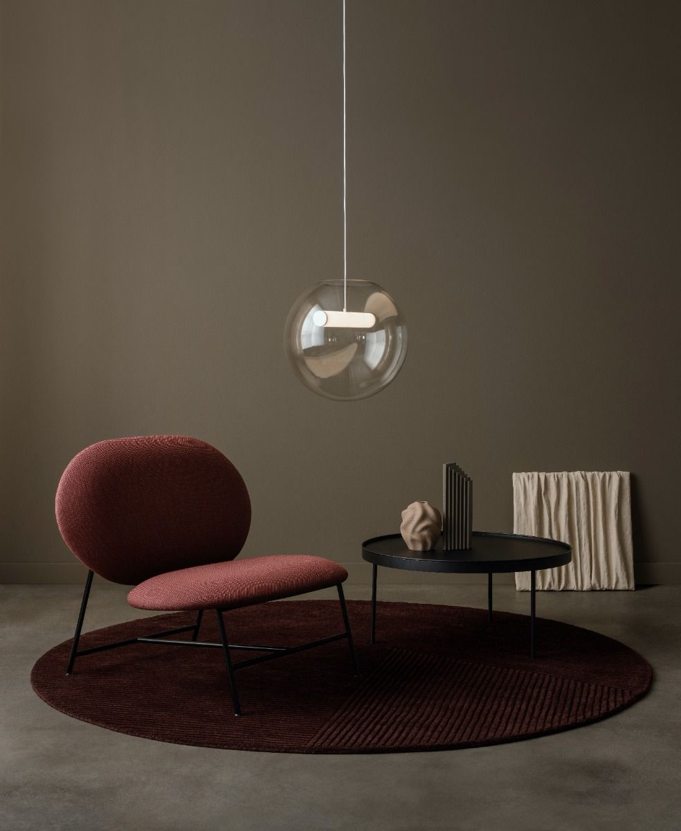 Northern Reveal pendant with a coffee table and chair