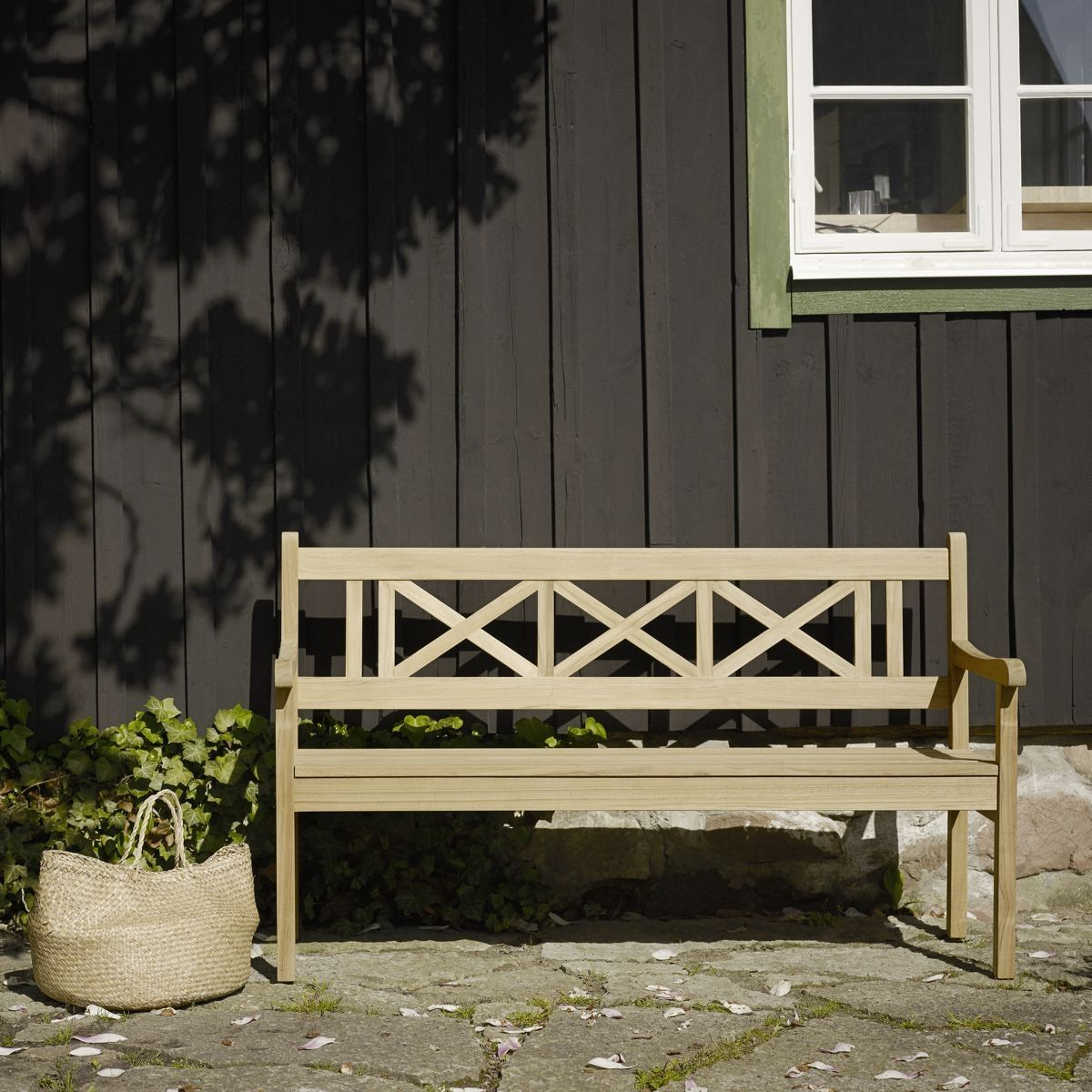 Skagerak Skagen Bench in front of black weatherboard building