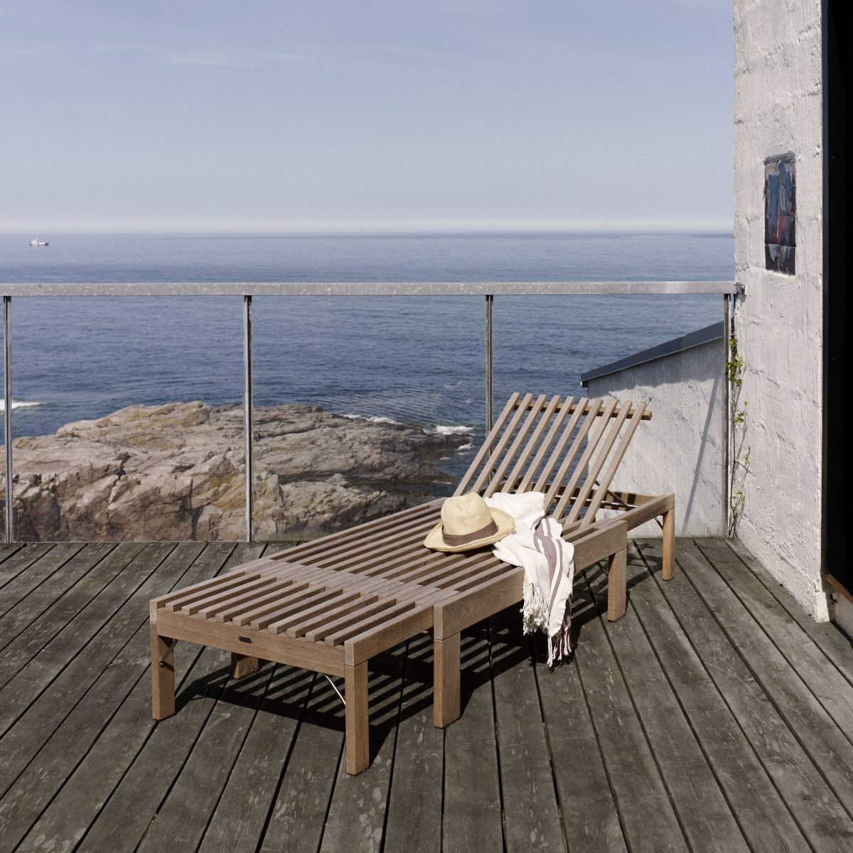 Skagerak Riviera Sunbed in decking by the beach