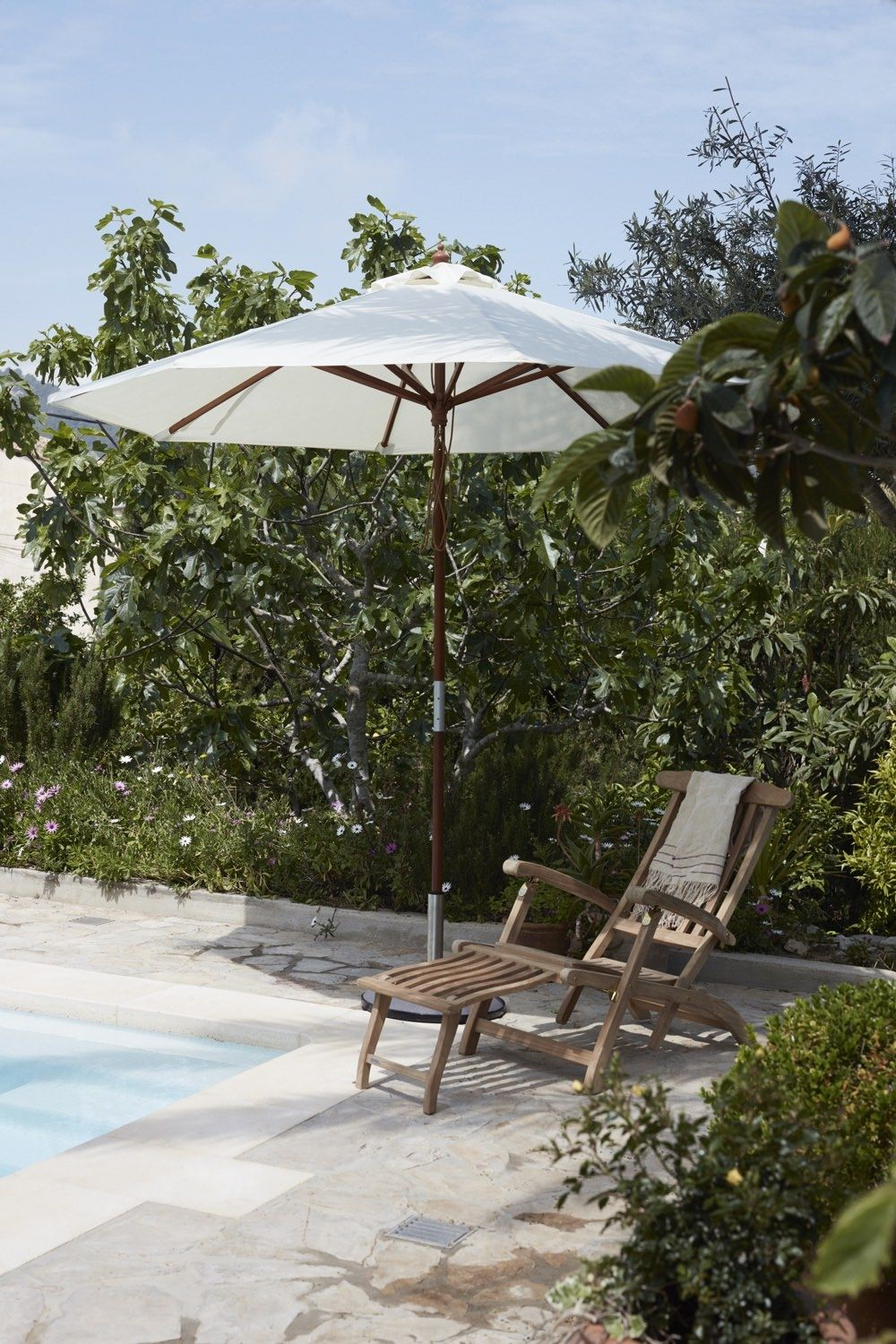 Skagerak Steamer Deck Chair by the pool under a parasol