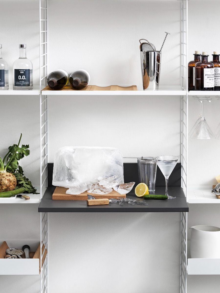 String shelving media shelf used as a drinks table