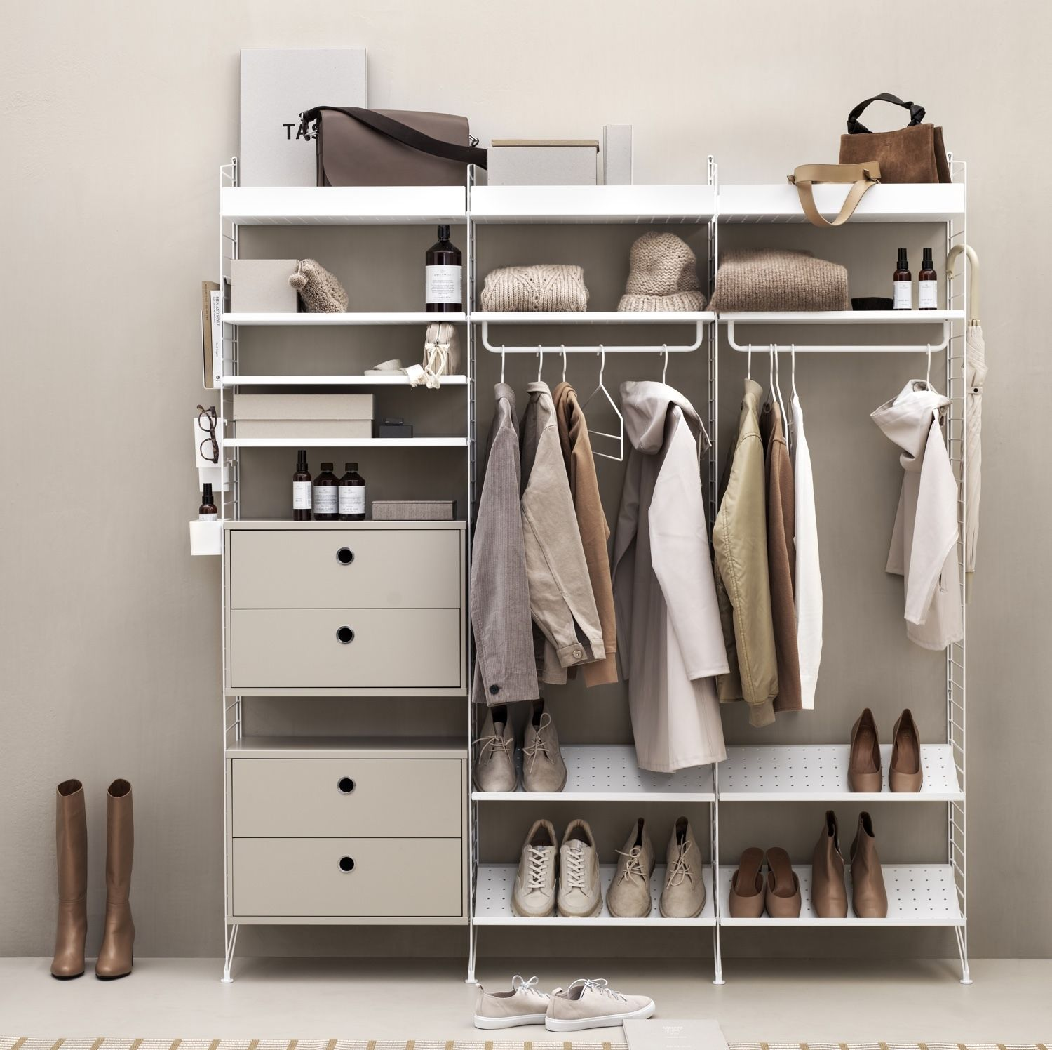 string shelving coat hangers in clothes storage system in ash and white