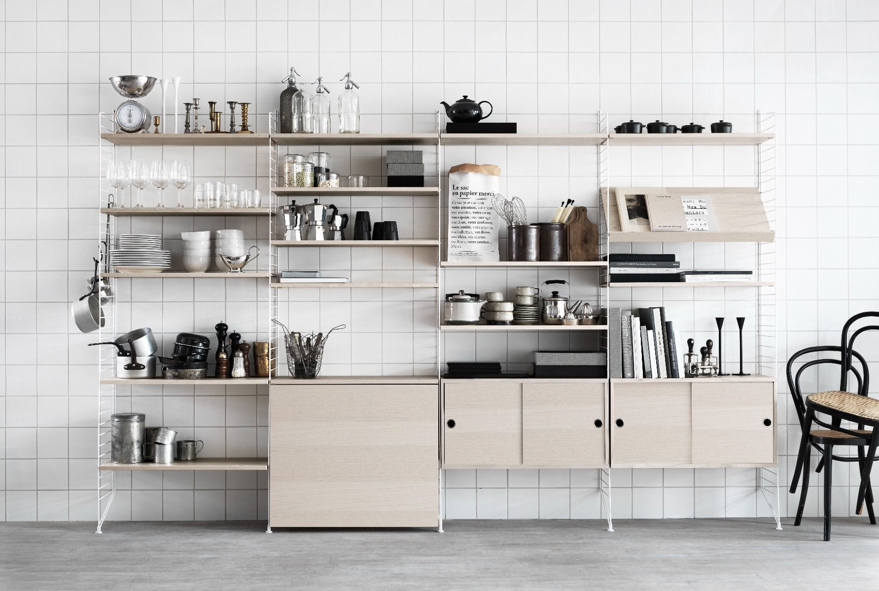 String shelving system for the kitchen in ash