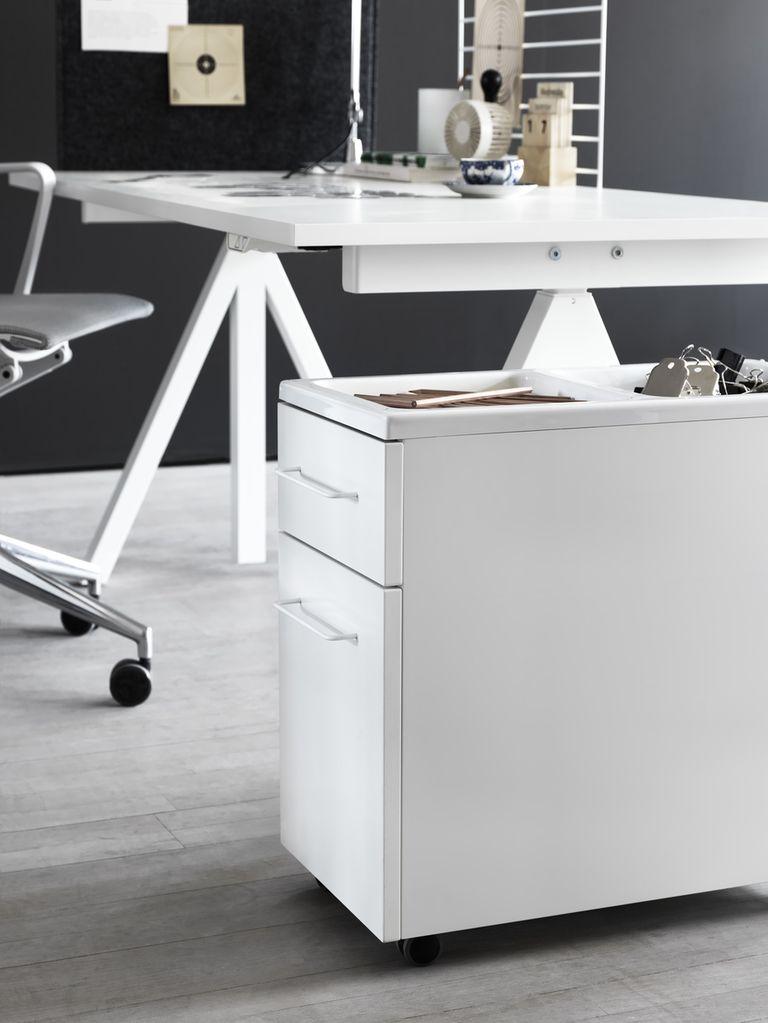 String works mobile storage unit white underneath a string works desk