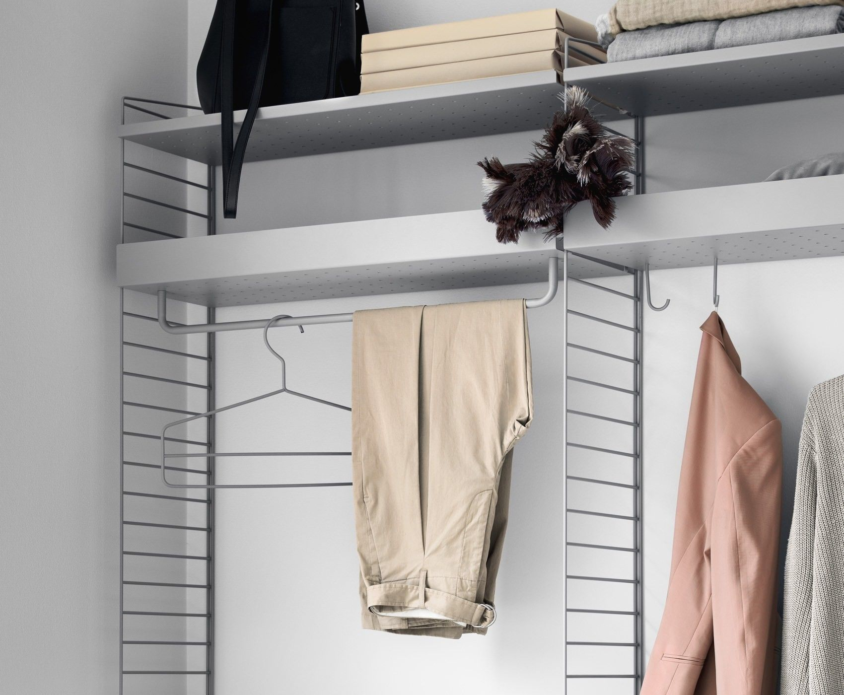 String shelving coat hanger in closet system