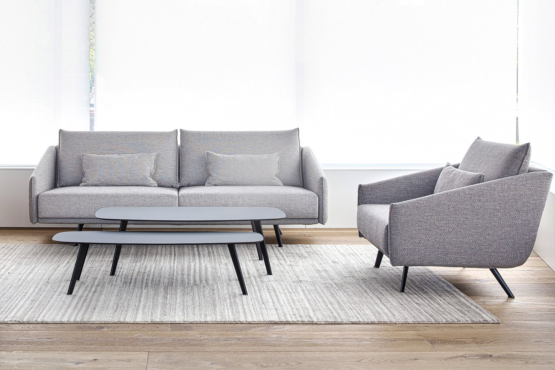 Stua Solapa Tables-Fenix in living room with costura sofa and arm chair