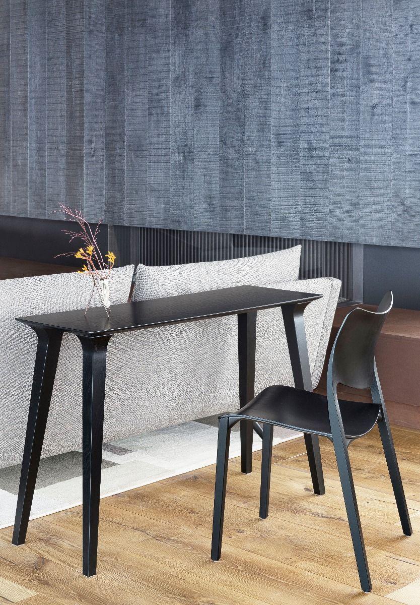 Stua Lau console table in black behind a sofa