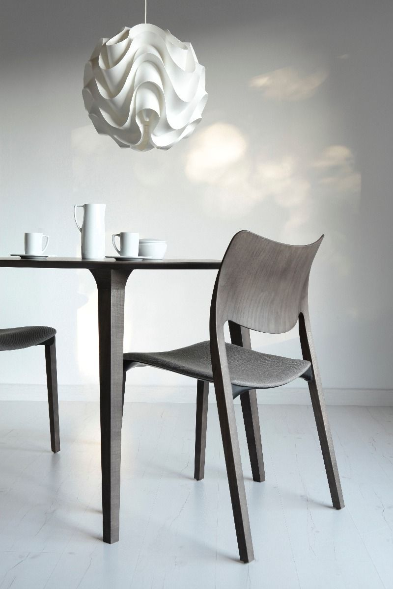 STUA Laclasica Chair in warm grey stain with a lau round table