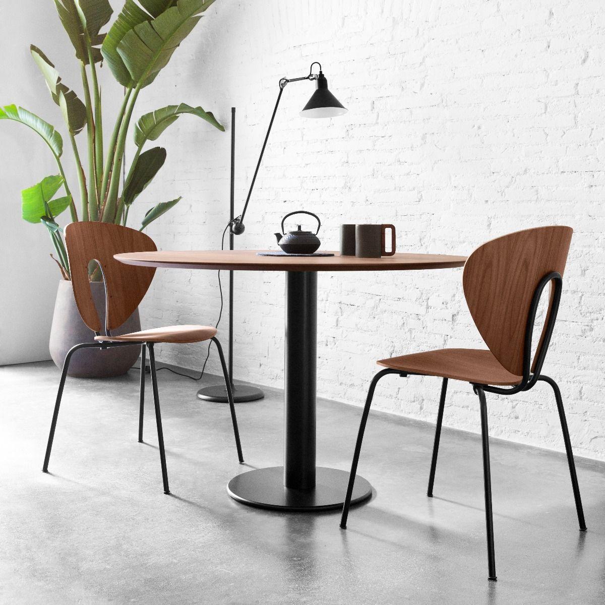 STUA Globus wood chair in walnut around a zero table