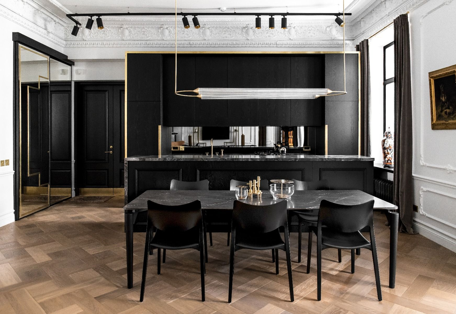 STUA Laclasica Chair with a black marble table in a black kitchen