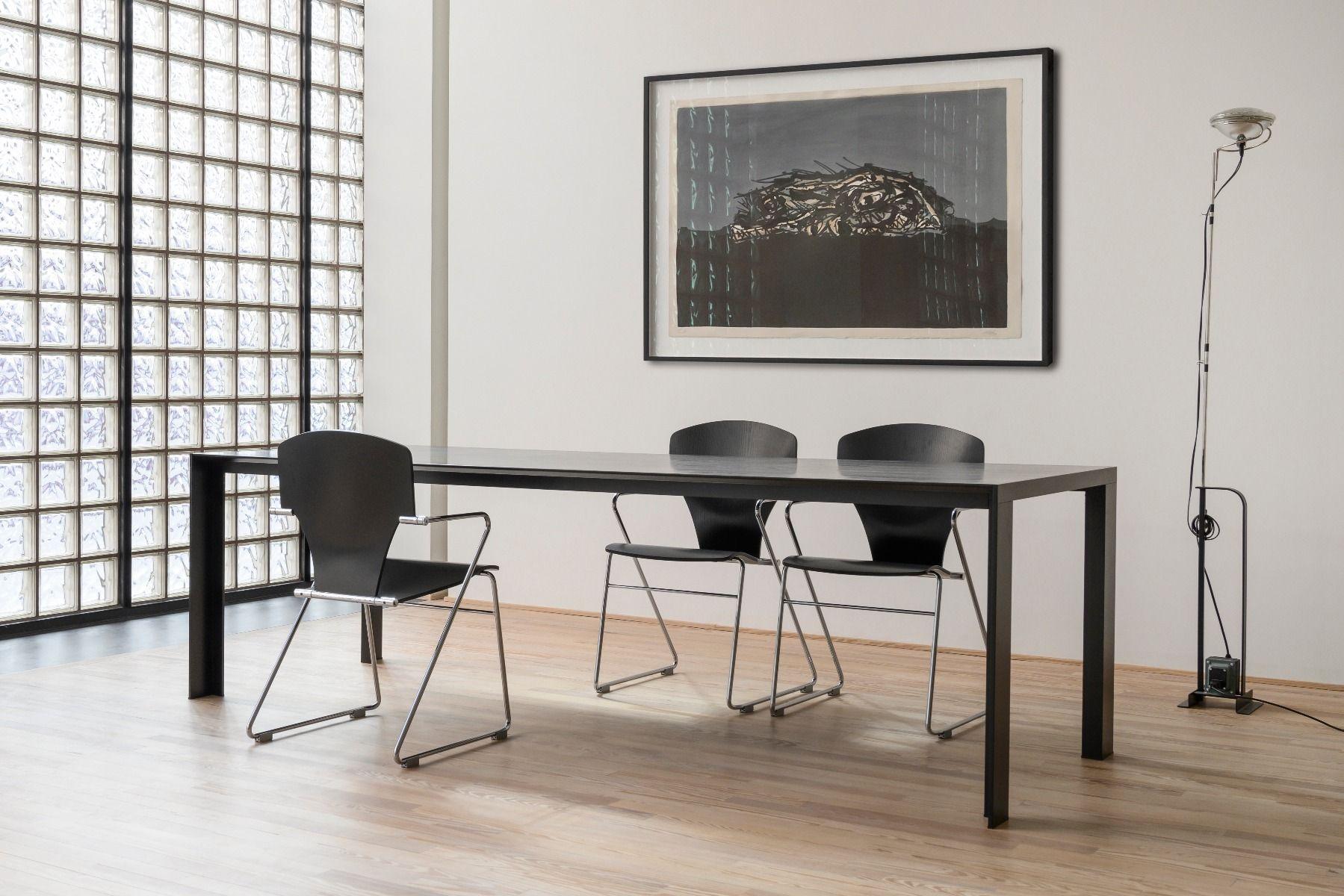 STUA Egoa Chairs around a black table