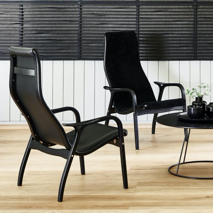 Swedese Lamino chair in black leather with a black frame  on a light oak floor