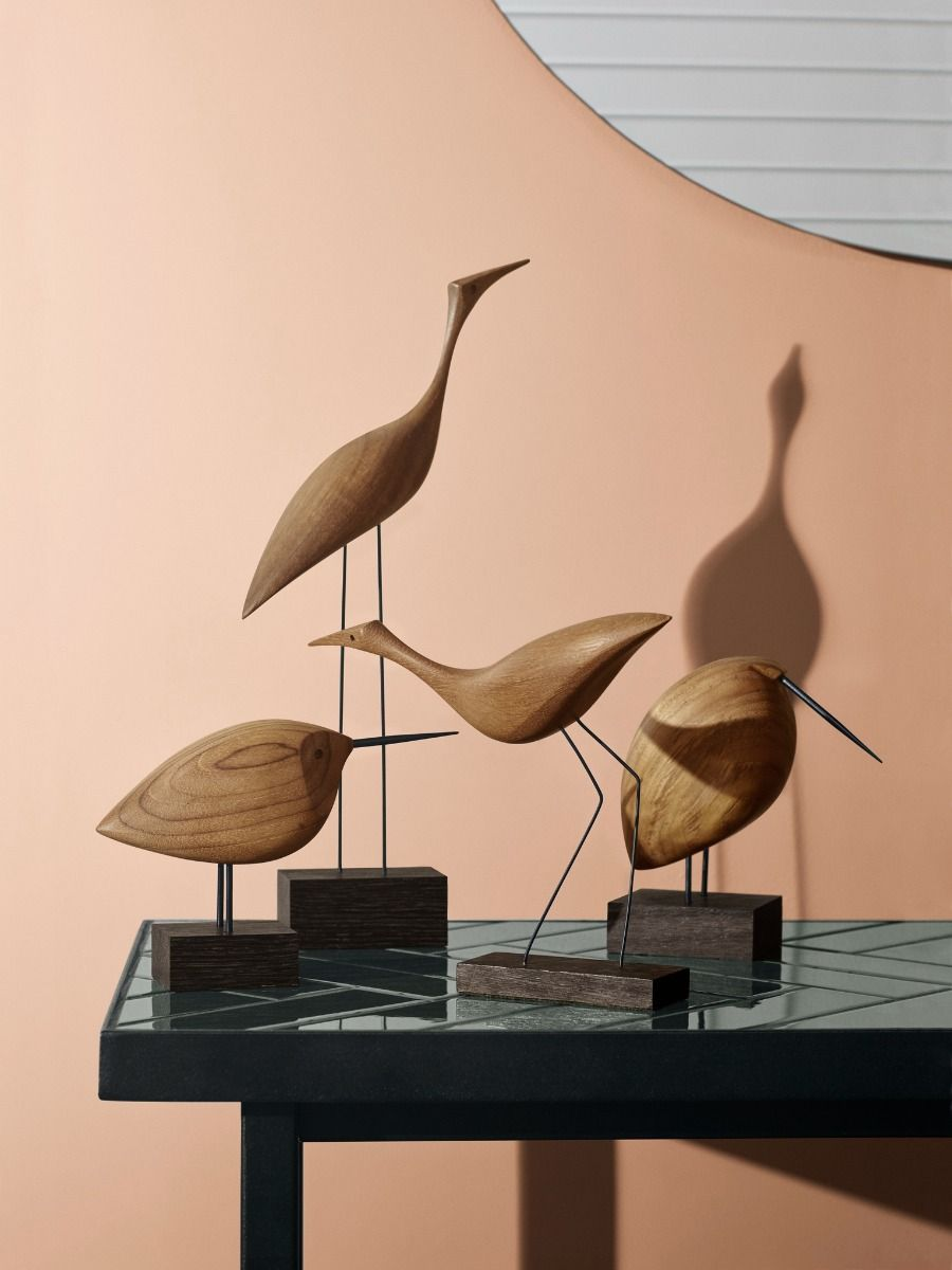 Warm Nordic Beak Bird collection on a tiled table