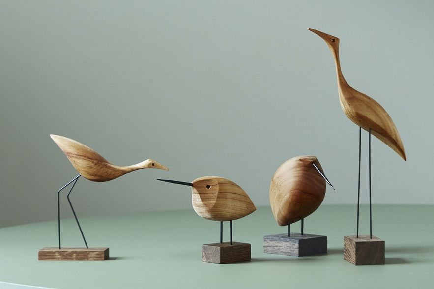 Warm Nordic Beak Bird collection on a green table