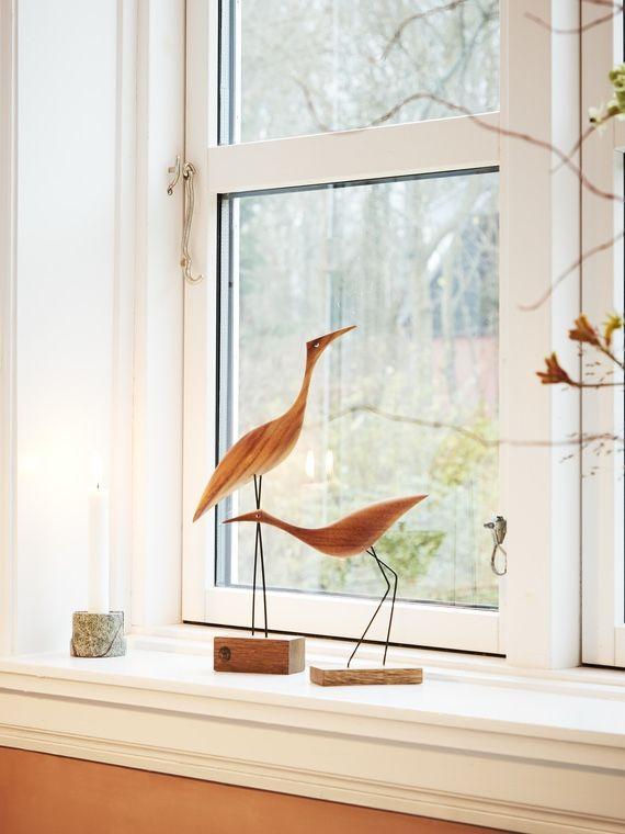 Warm Nordic Beak Bird - Low Heron on a window cill