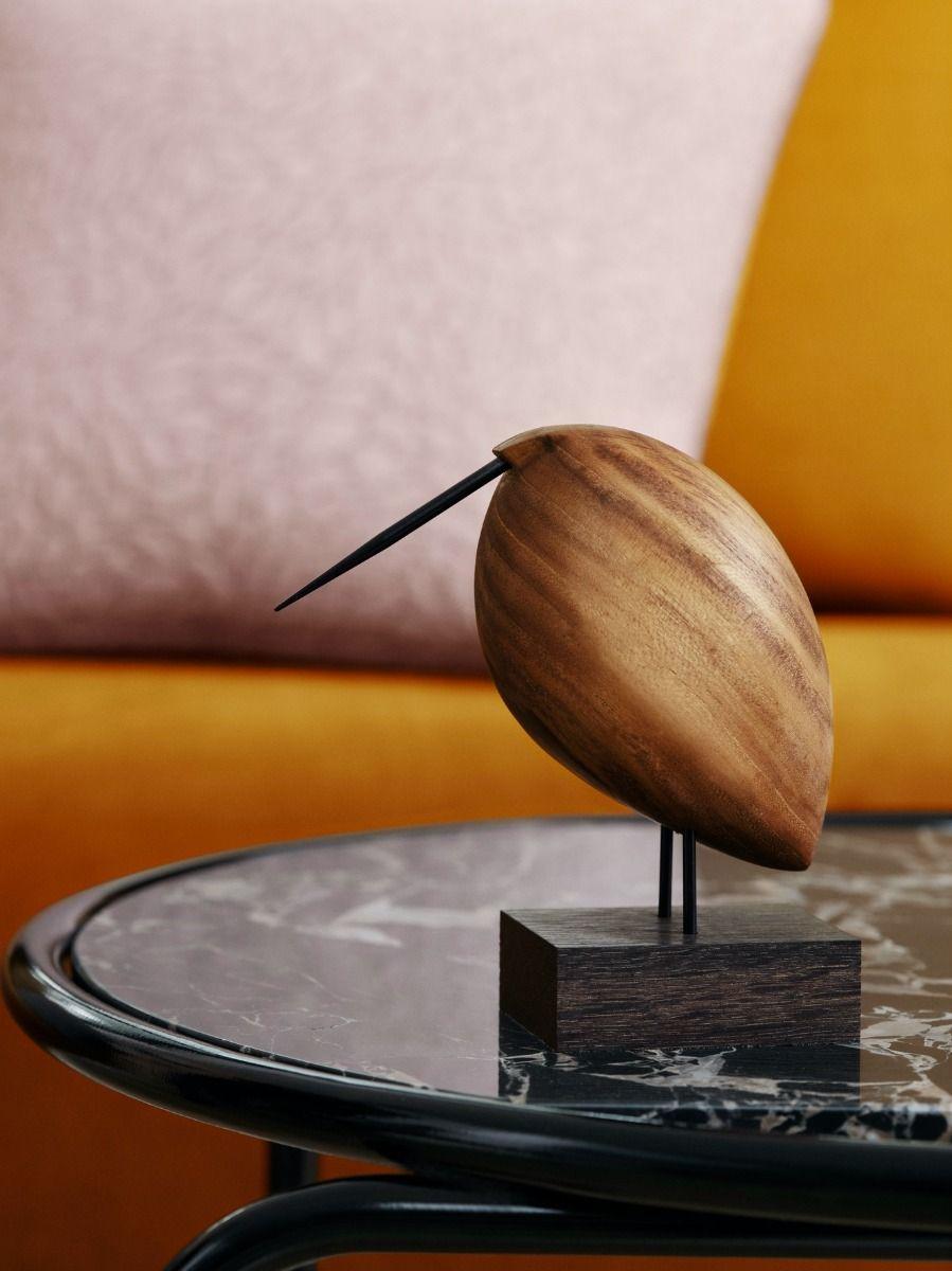 Warm Nordic Beak Bird - Lazy Snipe on a coffee table