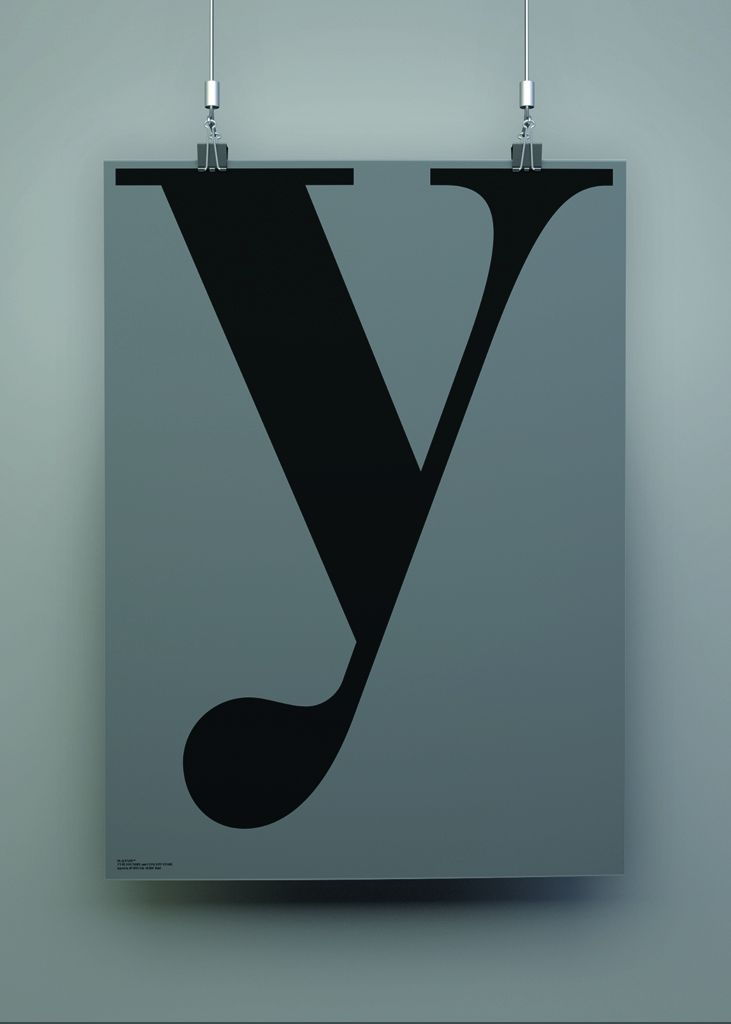 playtype grey y poster on a grey background suspended by hanging clips