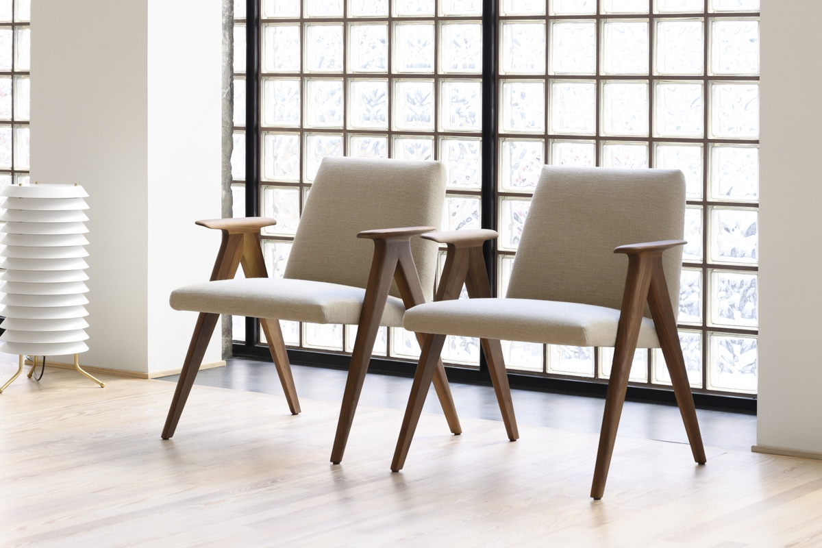 a pair of STUA Libera easy chairs